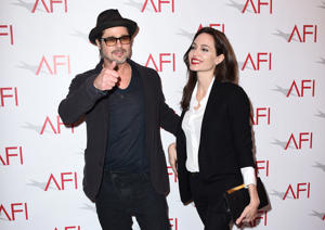 Brad Pitt, left, and Angelina Jolie arrive at the AFI Awards at The Four Seasons Hotel on Friday, Jan. 9, 2015 in Los Angeles.