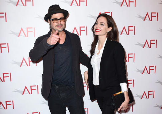 Slide 1 of 20: Brad Pitt, left, and Angelina Jolie arrive at the AFI Awards at The Four Seasons Hotel on Friday, Jan. 9, 2015 in Los Angeles.