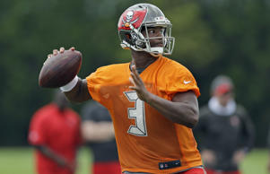 Tampa Bay Buccaneers quarterback Jameis Winston throws a pass during a Buccaneers NFL football mini camp Tuesday, June 16, 2015, in Tampa, Fla.