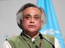 File: File: India's Environment Minister Jairam Ramesh gives a speech during a plenary session at the Moon Palace, where climate talks are taking place, in Cancun, December 8, 2010.