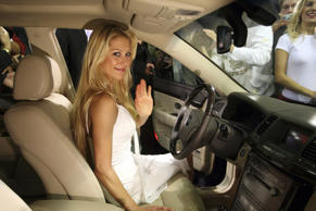 Here's Anna Kournikova once again, this time at the wheel of a Kia Opirus at the 2006 Korean Motor Show. No doubt Ms Kournikova loved the subtle hints of Mercedes-Benz and its affordable quality.