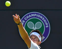 Kei Nishikori of Japan serves during his match against Simone Bolelli of Italy at the Wimbledon Tennis Championships in London, June 29, 2015.