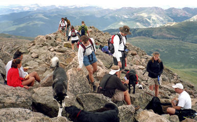 The rocky 14,060 foot summit of Mt. Bierstadt attracted a crowd of day hikers who stopped to rest and grab lunch before beginning the trip back down towards the trailhead at Guanella Pass . As one of the most accesible of the states 14'ers the peak draws hundreds of hikers every summer weekend. The mountain is named for German born painter Albert Bierstadt.