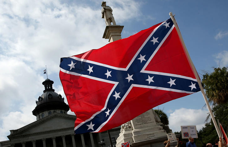 Demonstrators protest at the South Carolina State House calling for the Confederate flag to remain on the State House grounds June 27, 2015 in Columbia, S.C.