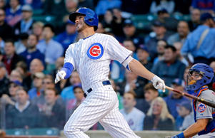 Kris Bryant of the Chicago Cubs hits a two-run home run against the New York Mets on May 11, 2015, in Chicago.