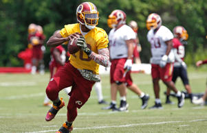 Jun 16, 2015; Ashburn, VA, USA; Washington Redskins quarterback Robert Griffin III prepares to throw the ball during drills as part of day one of Redskins Minicamp at Redskins Park.
