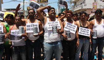 File: Youth congress activists staging a demonstration against state government demanding CBI probe on Vyapam scam in Bhopal on August 2, 2014.