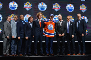 Connor McDavid poses with team executives after being selected as the number one overall pick to the Edmonton Oilers in the first round of the 2015 NHL Draft at BB&T Center.