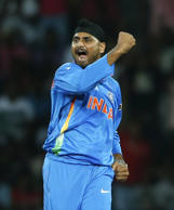 Indian bowler Harbhajan Singh celebrates the wicket of England's batsman Jonny Bairstow during an ICC Twenty20 Cricket World Cup match in Colombo, Sri Lanka, Sunday, Sept. 23, 2012 .