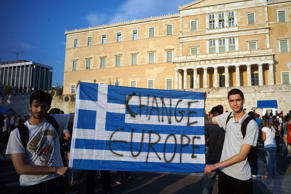 File: Demonstrators during a rally in Athens, Greece, 29 June 2015. Greek voters will decide in a referendum next Sunday on whether their government should accept an economic reform package put forth by Greece's creditor. Greece has imposed capital controls with the banks being closed untill the referendum.