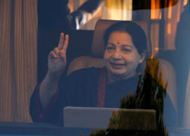 File: J. Jayalalithaa, chief minister of India's Tamil Nadu state and chief of Anna Dravida Munetra Khazhgam (AIADMK), gestures from inside a vehicle after addressing her party supporters during an election campaign rally in the southern Indian city of Chennai April 19, 2014.