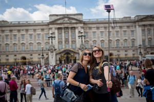 Tourists take a selfie in front of Buckingham Palace on June 24, 2015 in London, England.