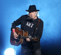 Neil Young performs onstage during the 2015 MusiCares Person of The Year honoring Bob Dylan held at Los Angeles Convention Center on February 6, 2015 in Los Angeles