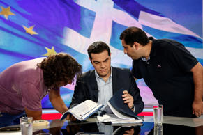 Alexis Tsipras, Greece's prime minister, center, waits for a televised interview to start inside a studio of Greek state television broadcaster ERT in Athens, Greece, on Monday, June 29, 2015.