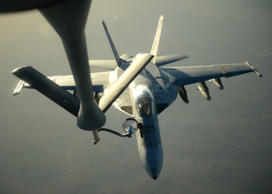 A U.S. Navy F-18E Super Hornet receives fuel from a KC-135 Stratotanker over northern Iraq after conducting air strikes in Syria in September 2014.