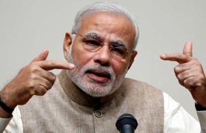 India's Prime Minister Narendra Modi gestures as he gives a speech.