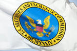 A flag bearing the logo of the U.S. Securities and Exchange Commission (SEC) waves outside the agency's headquarters in Washington, D.C., U.S., on Monday, April 19, 2010.