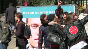 Putin's top critic, Navalny, faces threat of jail in new trial