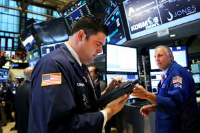Traders work on the floor of the New York Stock Exchange on September 2, 2014 in New York City. In morning trading after the holiday weekend, the Dow was down 20 points as global markets nervously watch developments in Russia and Ukraine.