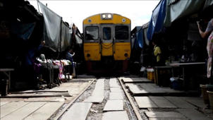 Thai food market doubles as railway track