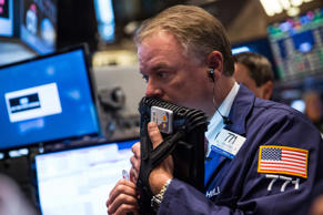 A trader works on the floor of the New York Stock Exchange during the afternoon of September 5, 2014 in New York City.