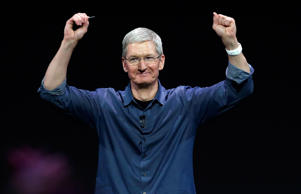 Apple CEO Tim Cook introduces the new Apple Watch, which he is wearing, on Tuesday, Sept. 9, 2014, in Cupertino, Calif. Apple's new wearable device marks the company's first major entry in a new product category since the iPad's debut in 2010. Marcio Jose Sanchez/AP Photo