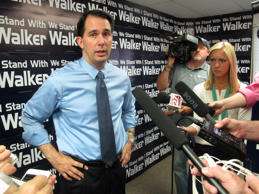 Wisconsin Gov. Scott Walker talks about a drop in state tax collections and a weak jobs report on Friday, Aug. 29, 2014, in Madison, Wis.