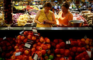 Shoppers examine produce at a Kroger store in Louisville, Ky.