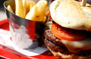 "File: A meal of a ""Monster""-sized A.1. Peppercorn burger, and Bottomless Steak Fries is seen at a Red Robin restaurant in Foxboro, Massachusetts July 30, 2014. If combined with a Monster Salted Caramel Milkshake, the dish was listed as the single unhealthiest meal to appear on the non-profit Center for Science in the Public Interest's (CSPI) Xtreme Eating Awards for 2014."