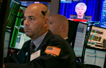 ​Federal Reserve Chair Janet Yellen's news conference appears on a television monitor on the floor of the New York Stock Exchange.