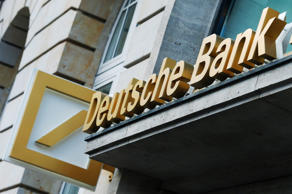 A logo sits on display outside a branch of Deutsche Bank AG in Frankfurt, Germany.