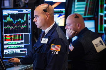A trader works on the floor of the New York Stock Exchange on Septemeber 15, 2014 in New York City. The Dow Jones Industrial Average rose 43 points and reached a near record high today, despite tech stocks sharply dropping.