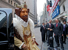 "Burger King CEO John W. Chidsey, background center, watches as""The King"" mascot of Burger King Corp., arrives at the New York Stock Exchange Thursday morning May 18, 2006. Burger King's parent company said Wednesday it expects to net $393 million from its initial public offering Thursday to pay off debt, as the No. 2 hamburger chain priced the sale at the top end of its expected range."