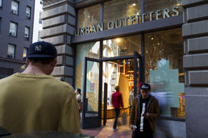 Pedestrians walk by an Urban Outfitters Inc. store in San Francisco, California, U.S., on Friday, Aug. 15, 2014.