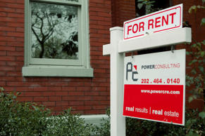 A for rent sign stands in front of a row house in the Logan Circle neighborhood of Washington, D.C. Andrew Harrer/Bloomberg/Getty Images