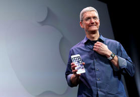 Apple CEO Tim Cook shows off the new iPhone 6 and the Apple Watch during an Appl...