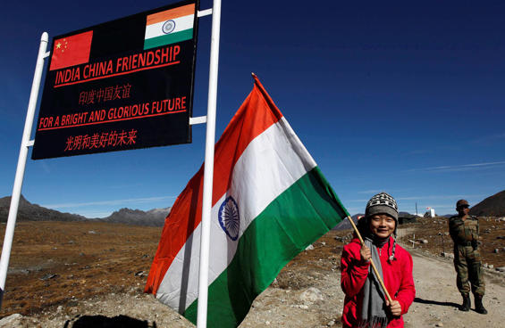 """Chinese troops hold a banner which reads, """"You've crossed the border, please go back"""", in Ladakh, India. (AP Photo)"""