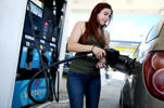 A customer pumps gas at the Victory gas station on April 21, 2014 in Pembroke Pines, Florida.