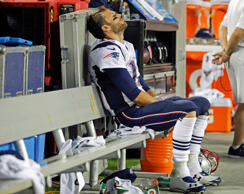 New England Patriots quarterback Tom Brady sits on the bench during the fourth quarter of an NFL football game against the Kansas City Chiefs, Monday, Sept. 29, 2014, in Kansas City, Mo.