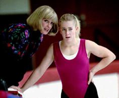 U.S. figure skating champion Tonya Harding (R) listens to her coach Diane Rawlinson during a practice session early 18 January 1994 in Portland, Oregon.