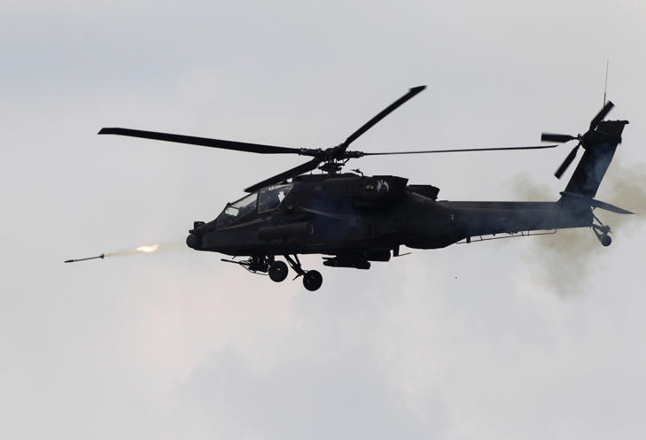File photo of a US Army AH-64 Apache helicopter taking part in a live-fire exercise.