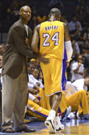 Oct 6, 2014; San Diego, CA, USA; Los Angeles Lakers head coach Byron Scott (left) pats guard Kobe Bryant (24) on the back during the first half against the Denver Nuggets at Valley View Casino Center.