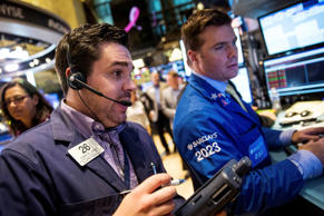 Traders work on the floor of the New York Stock Exchange during the afternoon of October 1, 2014 in New York City. The Dow Jones Industrial Average dropped over 230 points at the time of the closing bell.