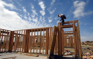 A construction worker works on the framing of a new home in Rodeo, California