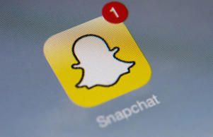 "The logo of mobile app ""Snapchat"" is displayed on a tablet on January 2, 2014 in Paris."