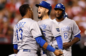 Eric Hosmer (center) of the Kansas City Royals celebrates his two-run home run with Salvador Perez in the 11th inning against the Los Angeles Angels in game two of their playoff matchup on Oct. 3 in Anaheim, Calif.