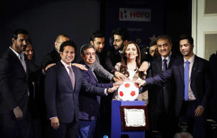 Club owners and representatives of sponsors and organisers take a pledge over a soccer ball replica during the emblem-unveiling ceremony of Indian Super League in Mumbai.