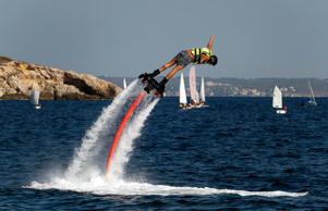 A man practices flyboard at the beach.