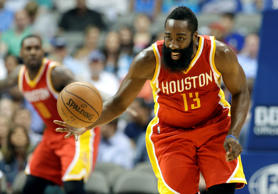 The Houston Rockets' James Harden comes away with a steal against the Dallas Mavericks on Oct. 7 in Dallas.