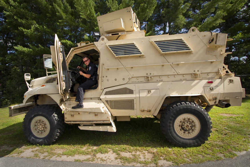 Sanford Police Chief Thomas Connolly steps down from the department's Mine-Resistant Ambush Protected (MRAP) vehicle.
